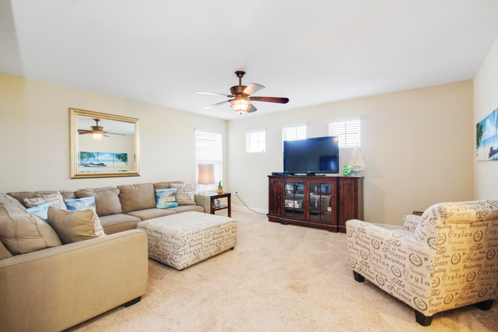 Plenty of seating in the upstairs retreat! Large flat screen and games consule!