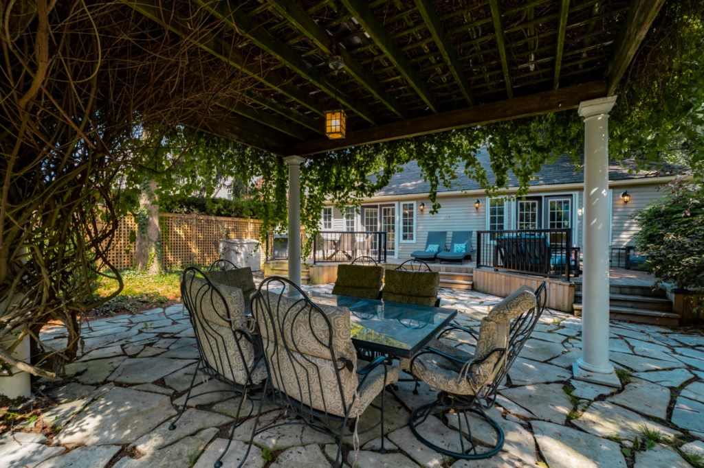 Outdoor dining under the vine covered arbour - La Vignette - Niagara-on-the-Lake