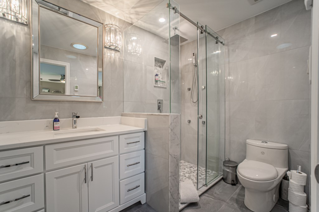 Ensuite bathroom with deluxe rainfall shower and full body spray, also has heated floor - La Vignett