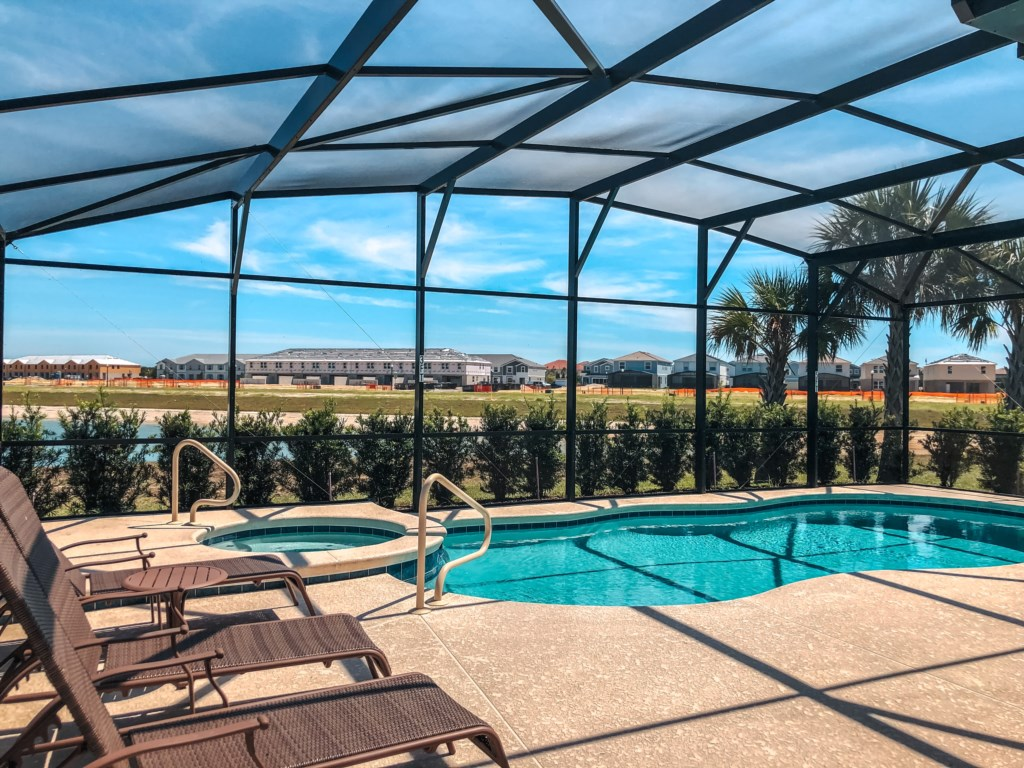 Enjoy lounging outside and getting sun all day on this south facing pool!