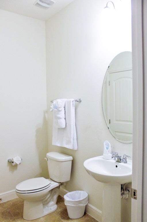 Main Floor Hallway Bathroom. Children's items will be found in this bathroom closet.