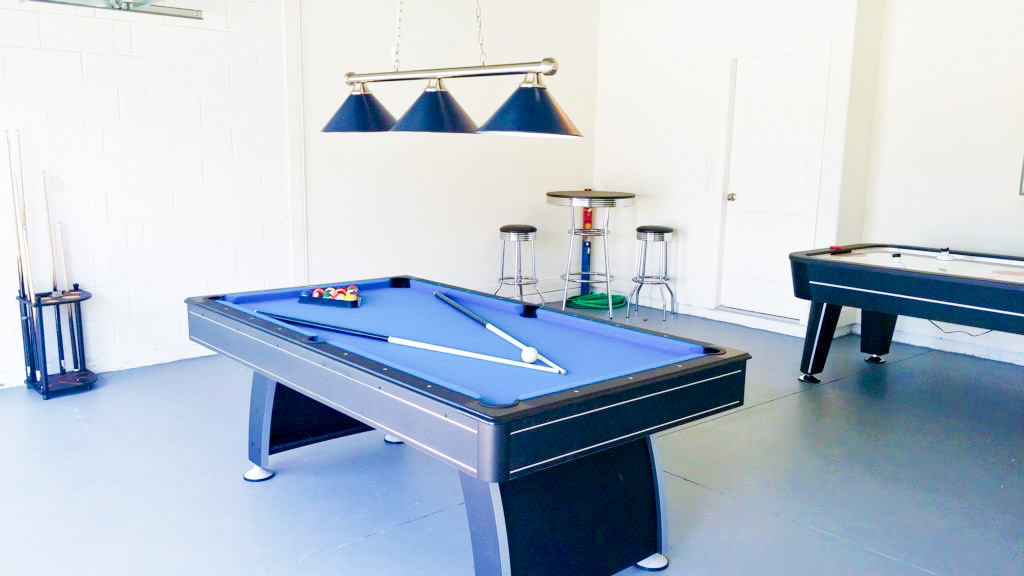 Large Games Room with Pool Table, Hockey Table, and Bar Seating!