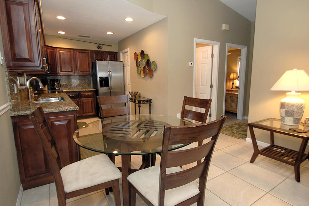 Kitchen with oak cupboards, granite counter tops and granite back splash