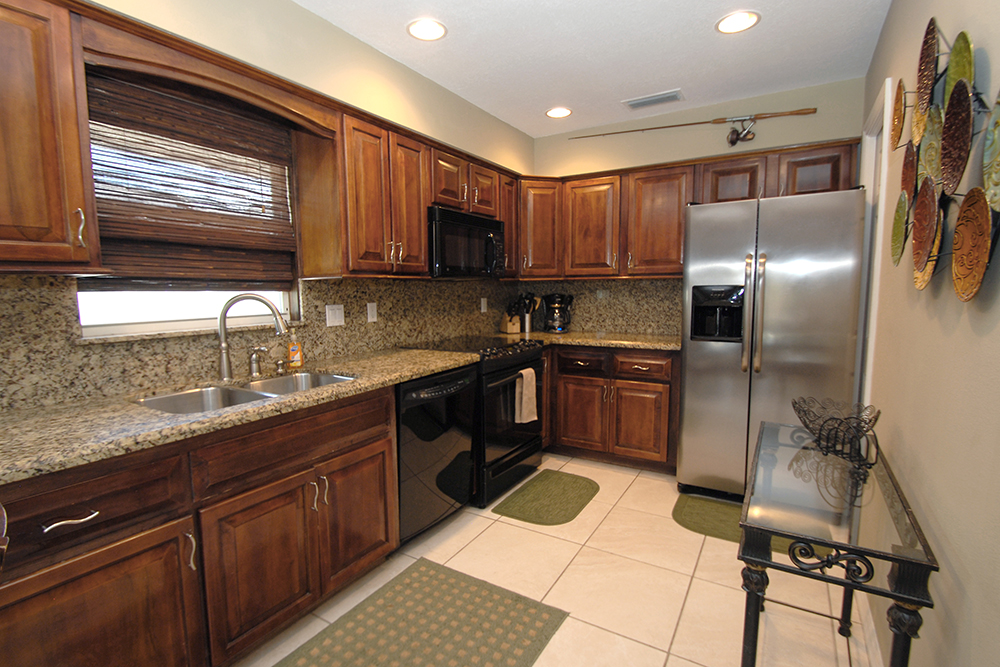 Designer kitchen with granite and stainless steel appliances