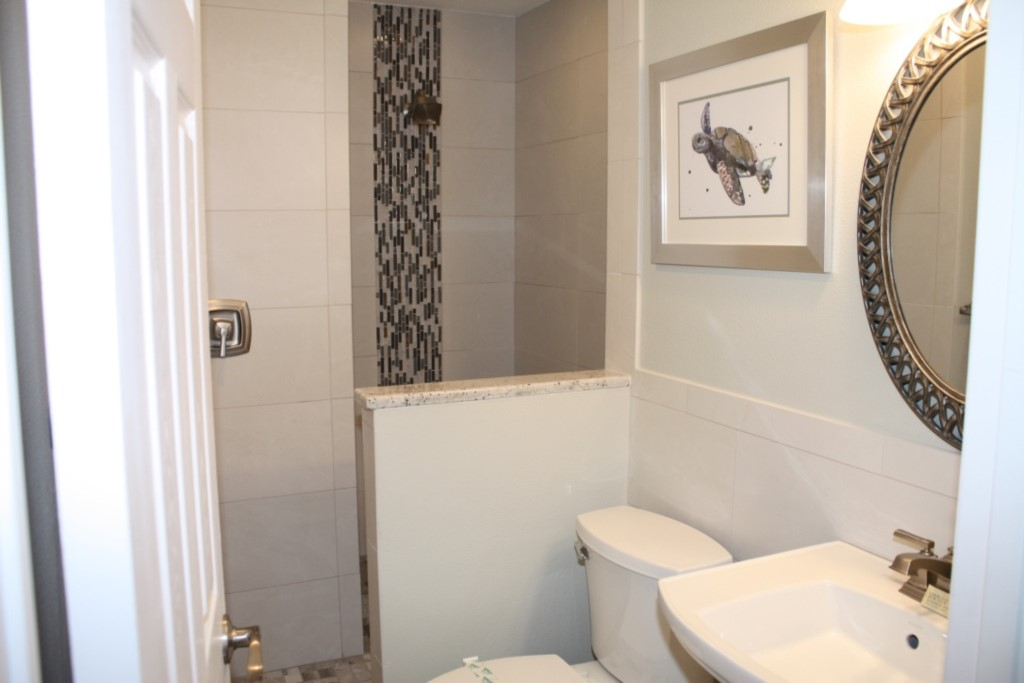 New walk in shower with granite counter tops