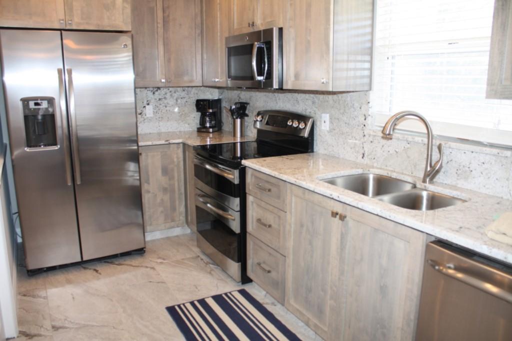 New designer kitchen, granite back splash and stainless steel appliances