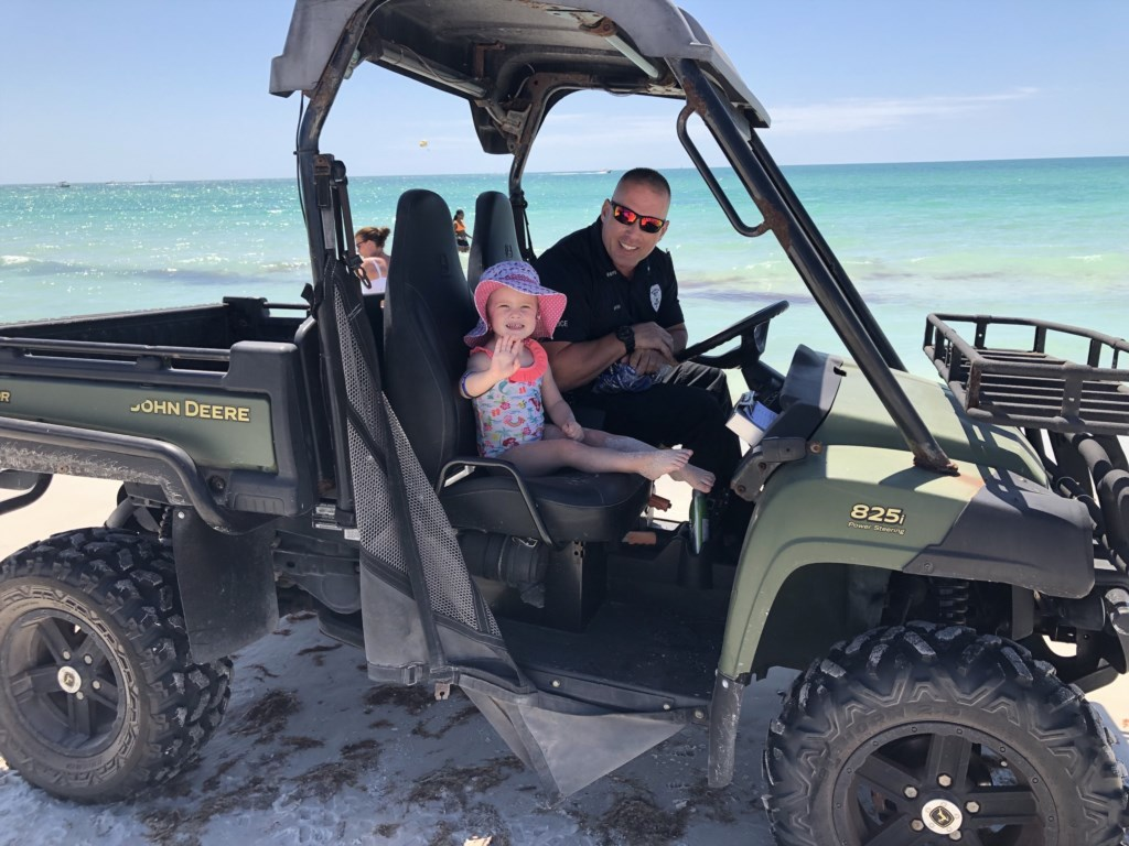 Our granddaughter getting arrested on the beach