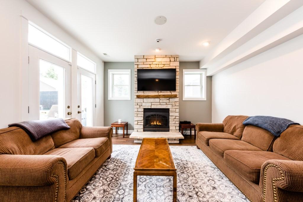 Walkout Basement Seating (TV & Fireplace)