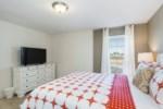 20_Queen_bedroom_with_TV_0721.jpg