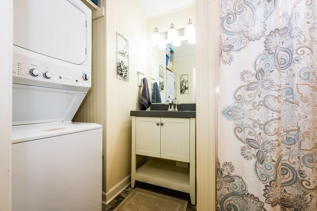Second floor bathroom (tub/shower & laundry room)