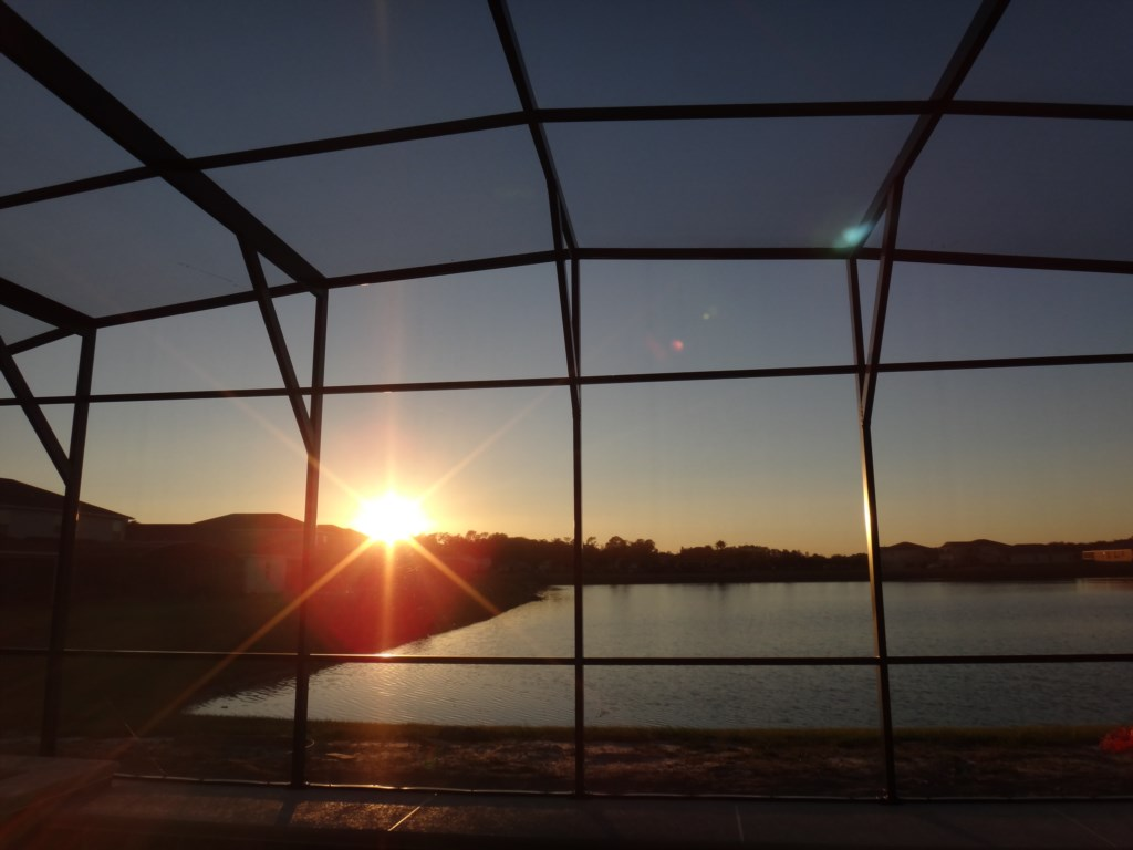 Large Screened-in Pool Deck Overlooking Lake - Nightly Sunsets