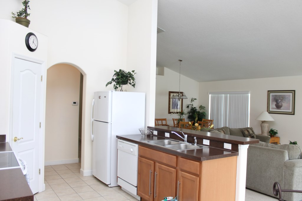 Kitchen opens to living room