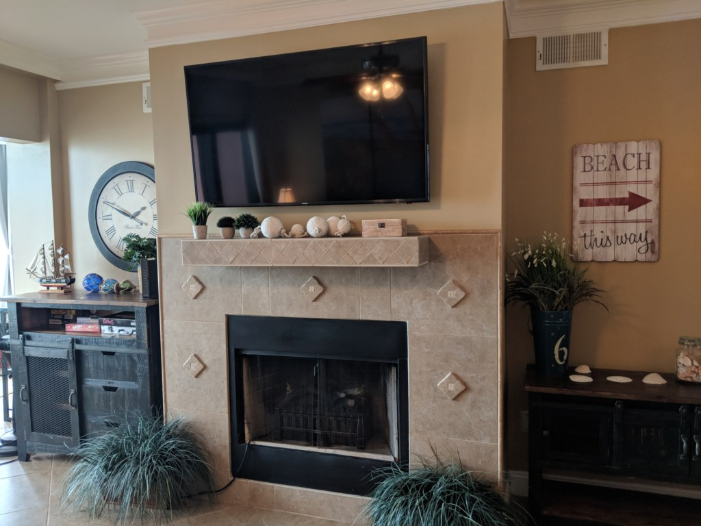 Large flat screen TV above the electric fireplace