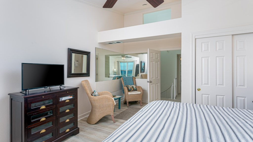 Cozy sitting area located in master bedroom