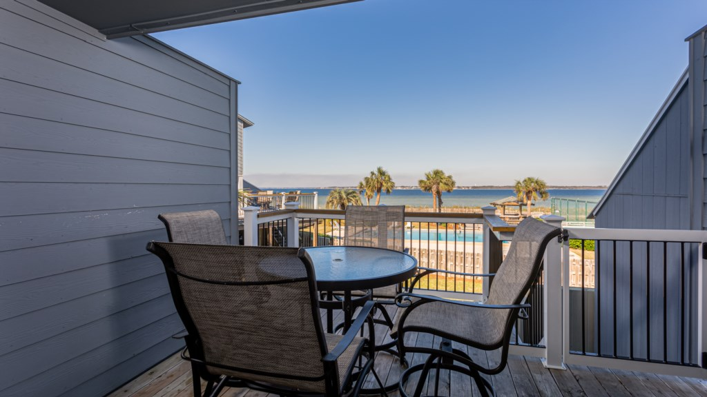 Back deck overlooking pool and Pensacola Bay