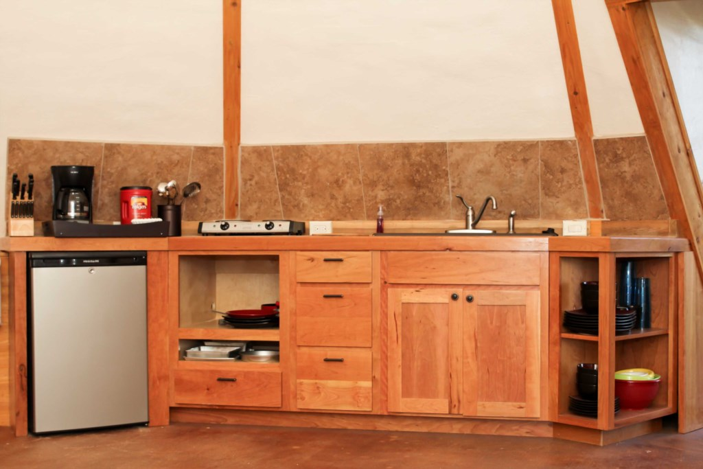 Kitchenette in each Tipi, with mini fridge, sink & cookware.