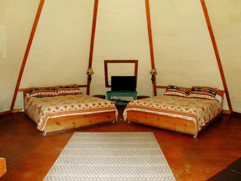 Tipi 1 has 2 queen beds and a foldout couch.  The occupancy is up to 6 guests.