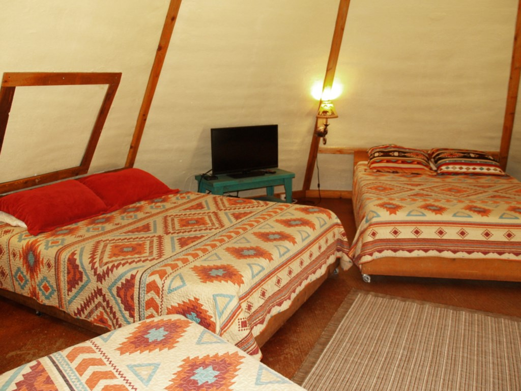 Tipi 5 has 3 Queen sized beds offering sleeping for up to 6 guests.