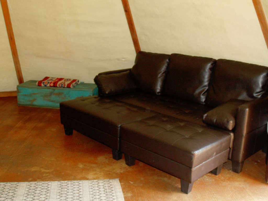 Tipi 7 has 2 queen sized beds and a modern fold-out sofa bed.
