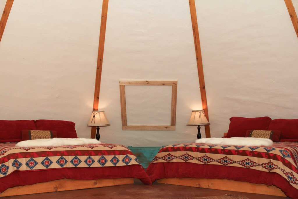 Tipi 7 has two Queen beds and a modern fold-out couch.