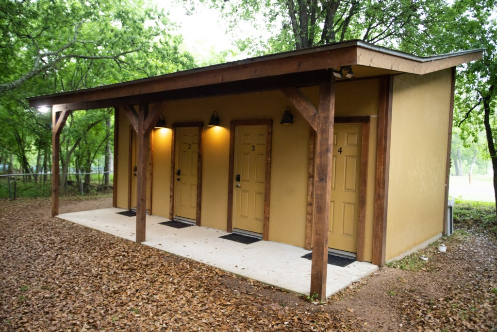 Bath House is located near the Tipis, and our guests have their own private bathroom!