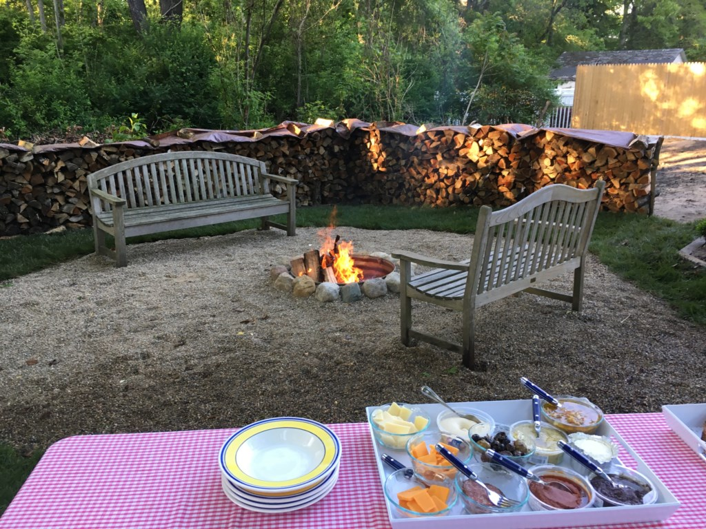 Firepit with lots of wooded provided as well as marshmallow sticks for S'Mores!