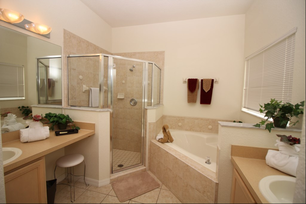 First Floor Master Bath with Walk-in Shower, Garden Tub, and  Twin Vanities