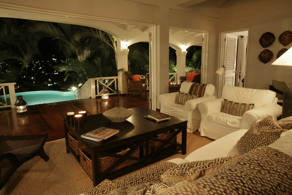 Living room looking out to the main balcony & pool