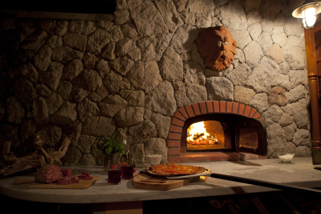 Pizza oven located near the kitchen.