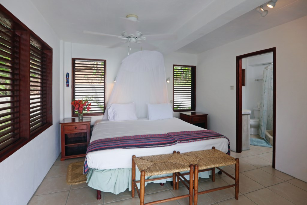 Bedroom 3 located in the building behind cottage. All four rooms are the same with ensuite