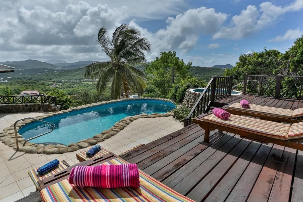 Sunning deck overlooking pool.