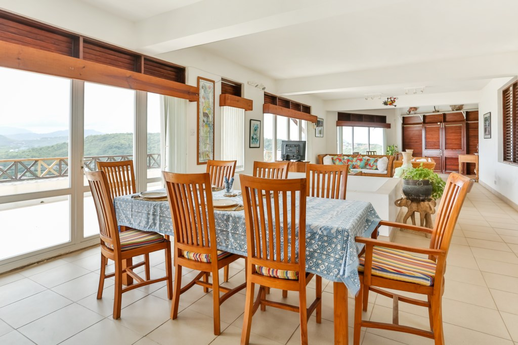 Formal dining looking over to living space.