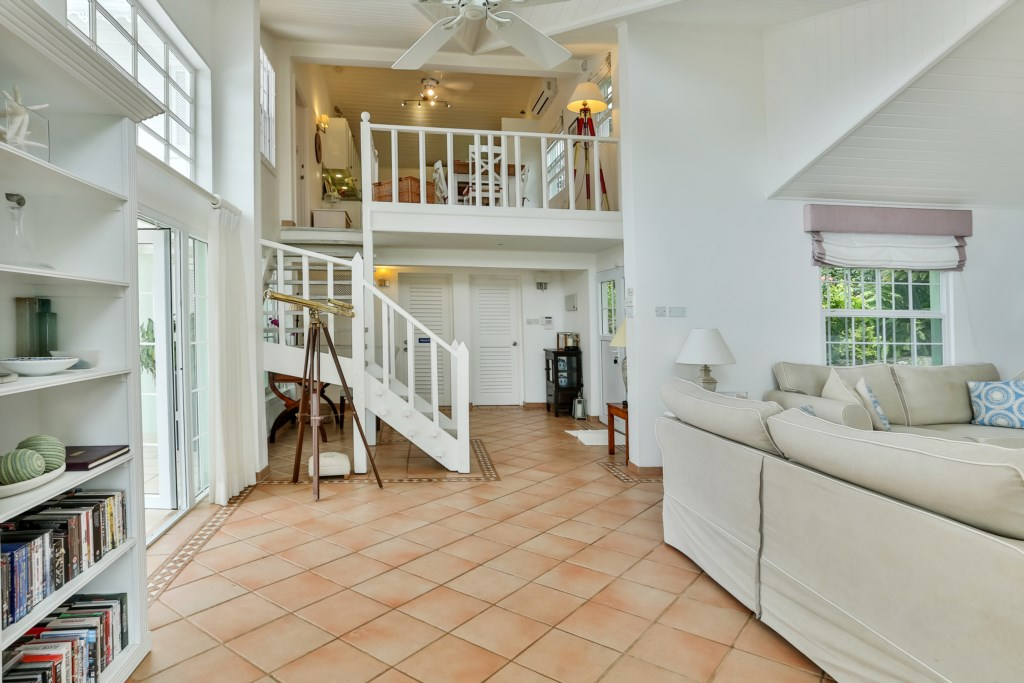 Stairs showing access to top floor where the formal dining, kitchen and two bedrooms are located.
