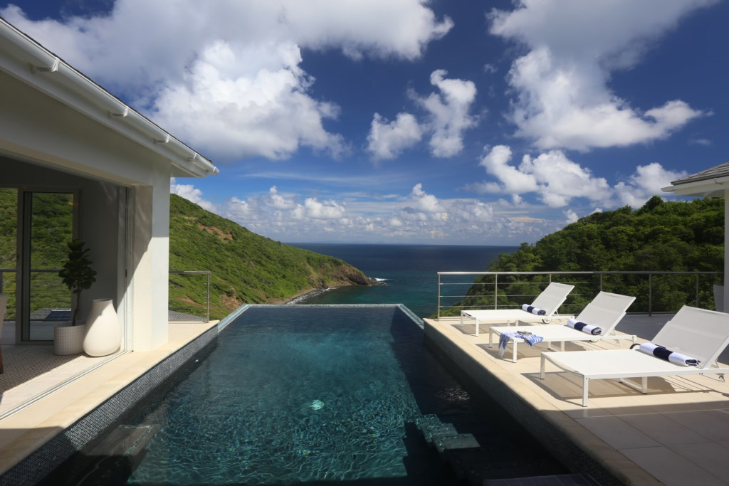 Custom deigned Onyx pool blends in with the ocean.