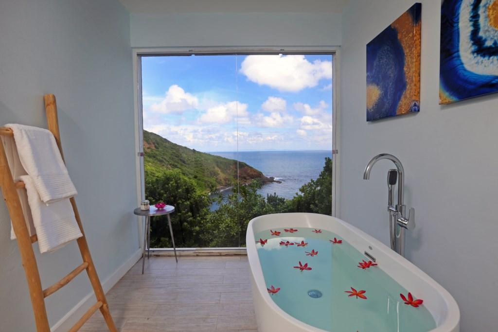 Master bathroom with soaking tub and views.