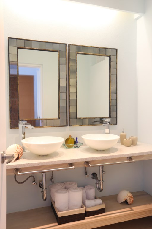 All bedrooms have identical ensuite bathrooms with double vanities.
