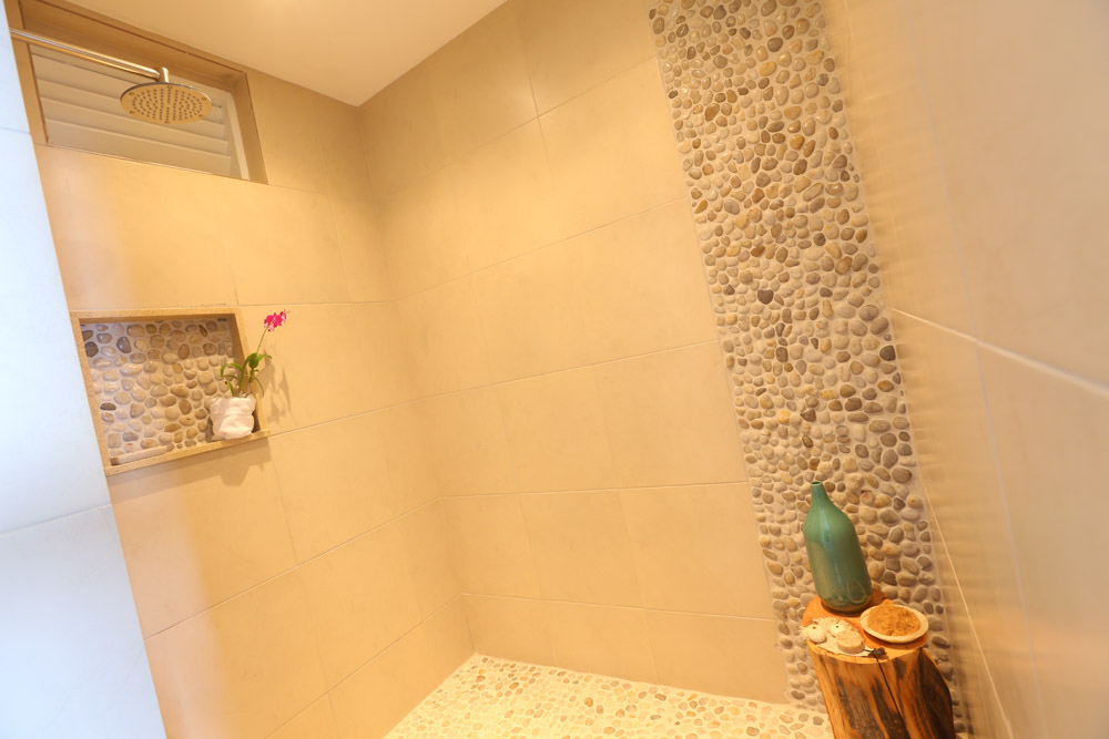 All bedrooms have identical ensuite bathrooms with showers.