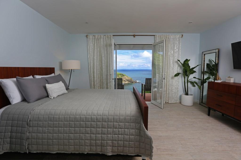 Bedroom three with Queen bed.