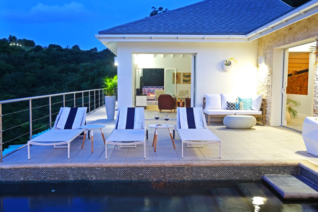 Pool deck area is accessible from the living space or dining space in the main living areas.