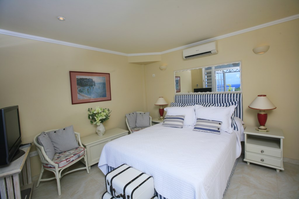 Bedroom three located on pool level and walks on to pool deck. Studio type room, with it's own ensuite and kitchenette.