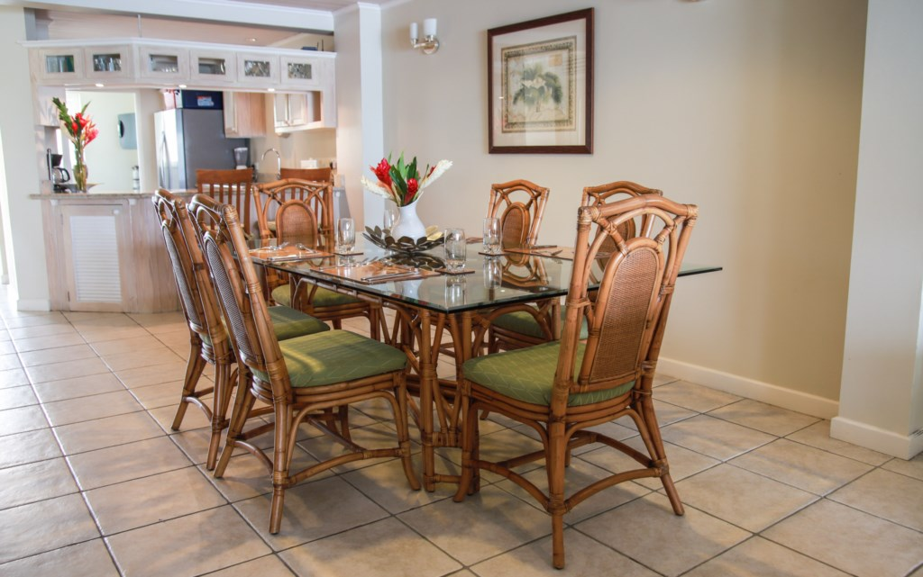 Formal dining with views out to the water.