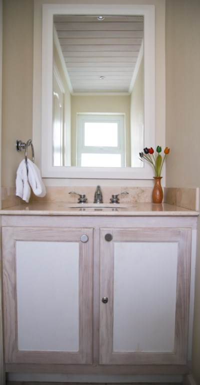 Powder room located off the kitchen.