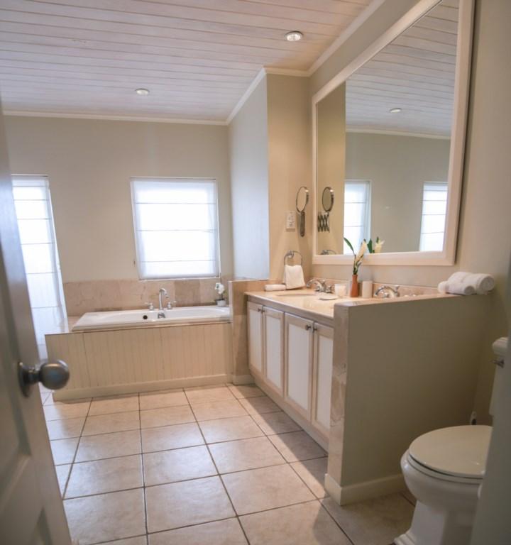 Master ensuite bathroom with double vanities.