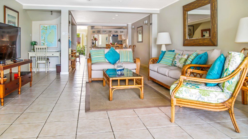 Spacious living space, walks out on to the patio overlooking the water.