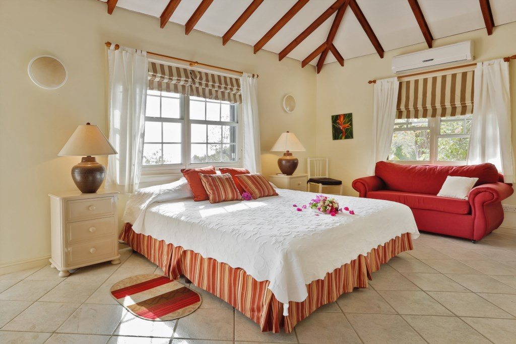 Cottage bedroom has a king sized bed