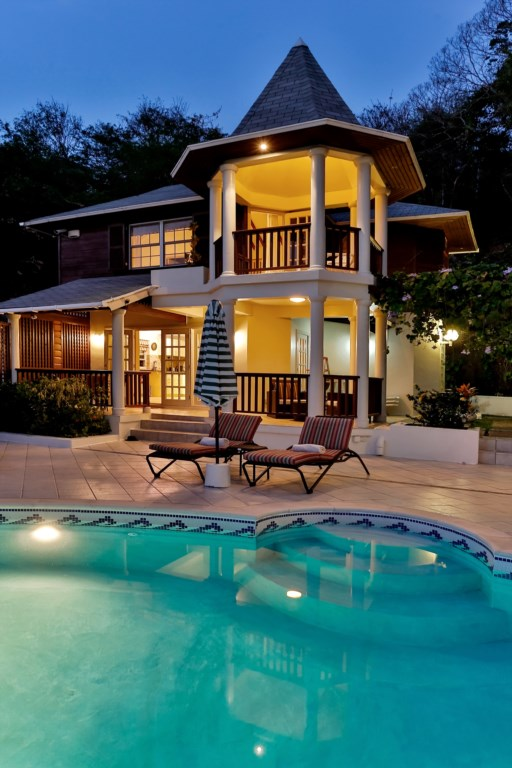 View of Cottage from pool in the evening