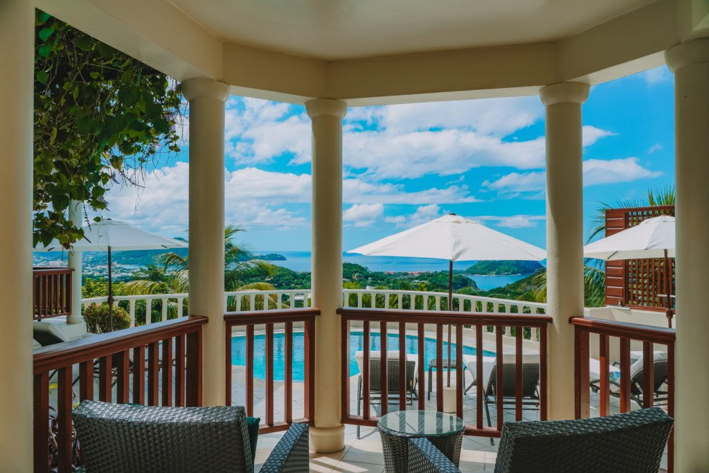 Patio off the cottage looking out to the pool & views.