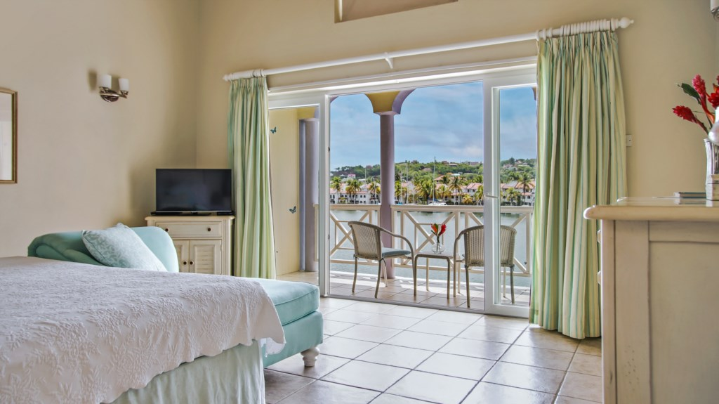 Master bedroom with it's own balcony and water views.