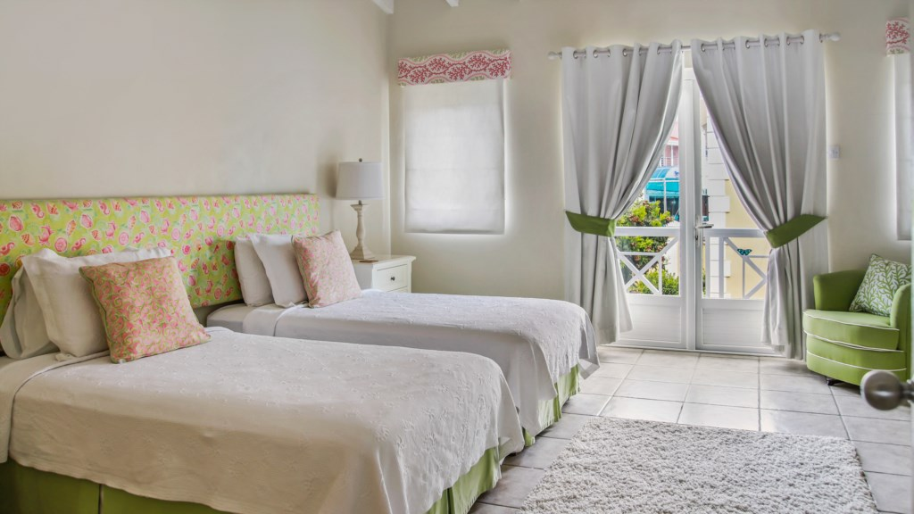 Bedroom 2 with two twin beds and views looking out to Rodney Bay.