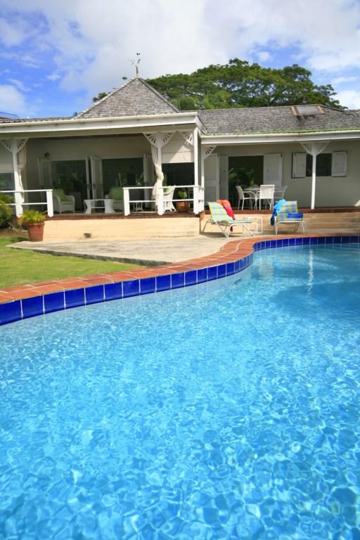 Pool area looking at villa